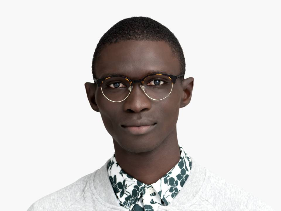 Men Model Image of Carey Eyeglasses Collection, by Warby Parker Brand, in Cognac Tortoise with Riesling Color