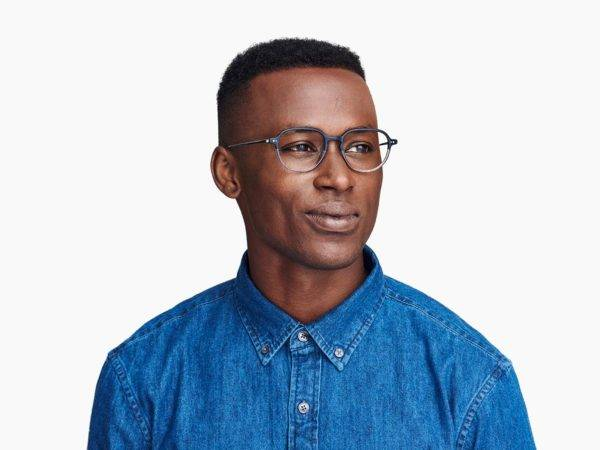 Men Model Image of Beasley Eyeglasses Collection, by Warby Parker Brand, in Woodgrain Tortoise with Polished Silver Color