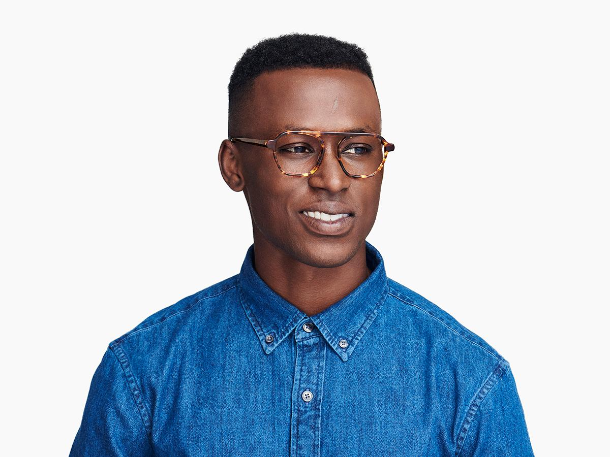 Men Model Image of Dorian Eyeglasses Collection, by Warby Parker Brand, in Root Beer Color